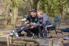 Mental health service users fish at Boggart Hole Clough, in Greater Manchester, with the aid of staff and occupational therapists. The NHS has teamed up with a fishing social group Tackling Minds to offer fishing to people with anxiety and depression. NHS Northern Care Alliance has become the first hospital trust in the UK to offer this scheme, Pictured in Greater Manchester, April 20 2021.